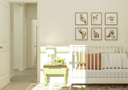 Rendering of a secondary bedroom with a   white crib and light wood nightstand. The hallway is visible through the open   door.