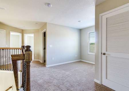 View of the upstairs game room in the Tomoka floor plan with recessed lighting a window and carpet flooring.