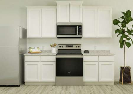 Rendering of kitchen area with countertop   and cookbook with white finishes.