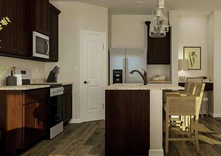 Rendering of the kitchen with brown   cabinetry, stainless steel appliances and granite counters. A built-in desk   is visible next to the kitchen.
