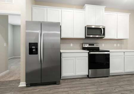 Close up of stainless steel appliances and white cabinetry in the heart of the home.