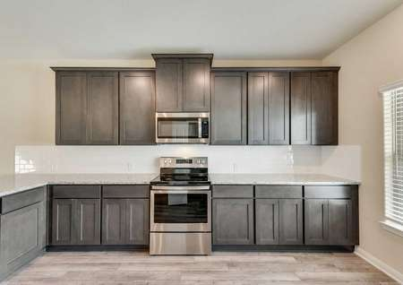 Tahoe kitchen with wood finish flooring, stainless steel appliances, and granite countertops  Download