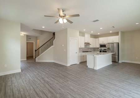 Entertainment space in this home includes an open-concept layout with a dining room, family room and chef-ready kitchen.