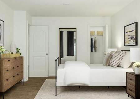 Rendering of a large bedroom showing a   rod-iron bed and nightstands across from the wall holding the wooden dresser.   A mirror and closet are visible on the back wall.