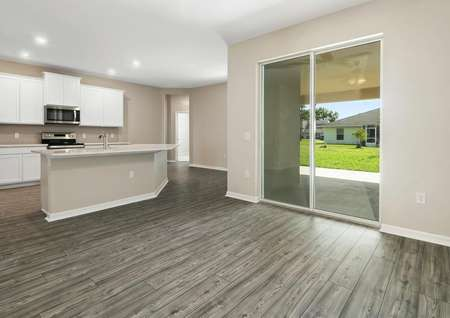 Open-concept family room, chef-ready kitchen and covered back patio.