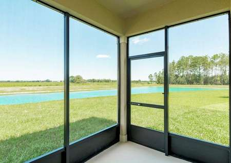 An enclosed and covered patio in the Tuscany floor plan with an open view of a golf course.
