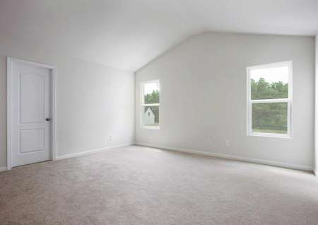Hartford bedroom with two windows, vaulted ceiling, and light brown carpeting