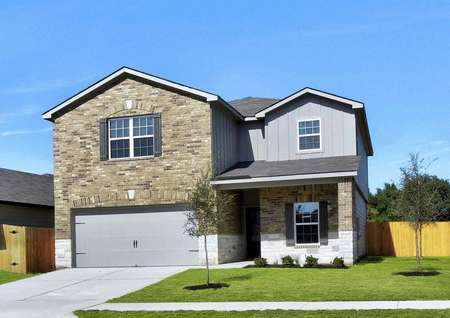 Victoria finished house with two levels, green landscaped yard, and multi-finish siding