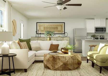 Rendering of living room with large   couch, additional seating, round coffee table, and side table.