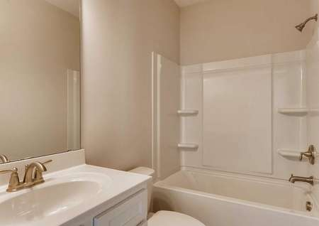 Hawthorn bath with shower/bathtub combo unit, white fixtures, and modern faucet