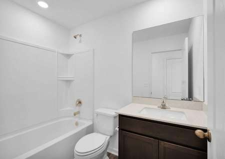 A full bathroom that is centrally located in the home.
