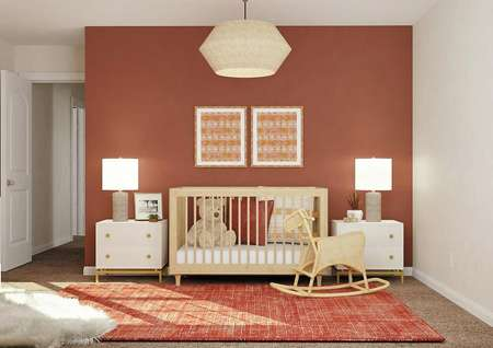 Rendering of a secondary bedroom   decorated as a nursery with a crib, two nightstands, a rocking horse and   dresser. The space has a rust-colored accent wall and carpeted flooring.