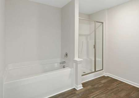 Burton master bathroom with separate shower and bathtub, recessed lights, and white trimmed walls