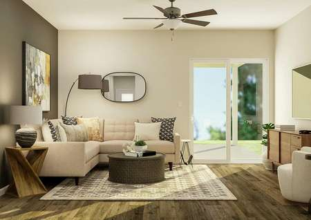 Rendering of the living room with the   white sectional couch on the left, a sliding glass door to the right and a   mounted tv with cabinet under it are on the right wall. The flooring is a   wood style vinyl plank.