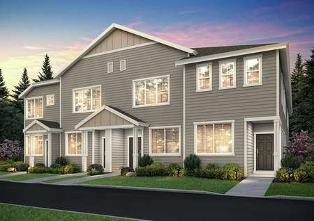 Angled view of the Harts Crossing townhome plans at night, focused on the right Cherry unit.