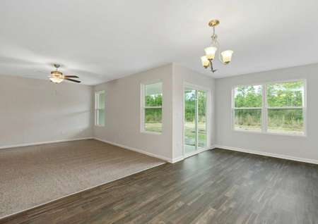 Burton great room with carpet in the family room, hardwood-style tile in the dining nook, and ceiling lights in both