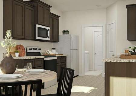 Rendering looking from the dining room   into the kitchen, which has brown cabinets, stainless steel appliances and   granite counters
