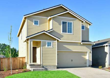 Hawthorn finished home with yellow siding, white accent paint, and landscaped yard