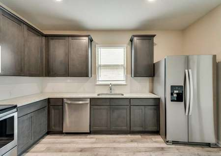 Ontario kitchen plan with stainless steel appliances, subway tile backsplash and dark brown finish cabinets