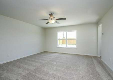 Trinity great room with carpeted floor, overhead ceiling light with fan, and white baseboards on gray walls