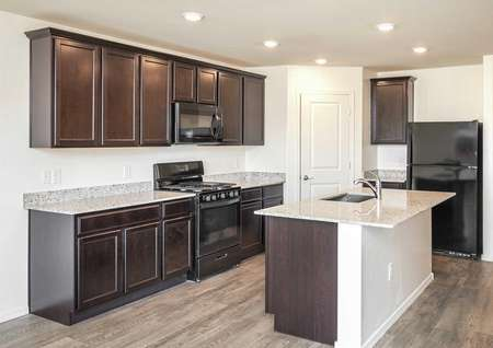 The Roosevelt floor plan kitchen offering another view of island and black appliances.
