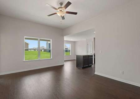 Blanco house finished with rich wood look floors, white on grey walls, and ceiling fan