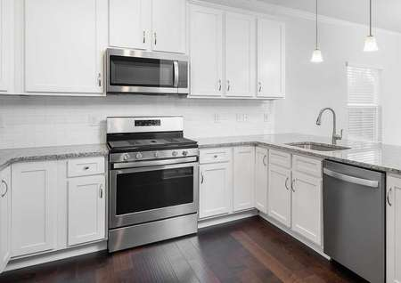 Fripp kitchen with stainless steel appliances.