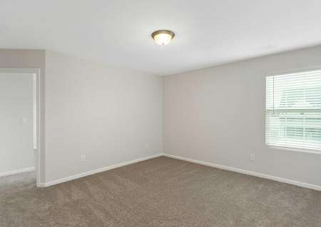 Avery new home bedroom with brown carpeting, window with blinds, and fixed light in the ceiling