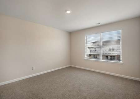 The master suite has brown carpet and tan walls with white trim.