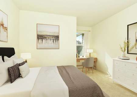staged bedroom with queen bed, desk in alcove with window, art on wall, gray