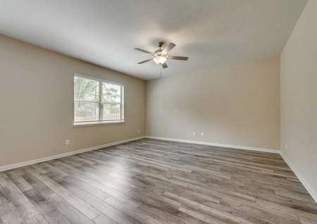 Saint Clair finished floor plan interior with wood style ceramic floors, white on brown colored walls, and overhead ceiling fan
