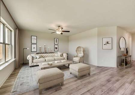 Rio Grande new home model completed with mid-century modern white colored sofa and ottomans, white Victorian era chair, and large light color throw rug
