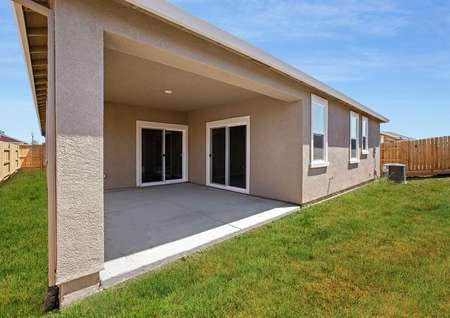 Enjoy a spacious covered patio and fenced back yard.