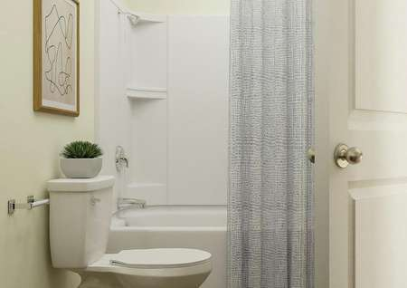 Rendering of white toilet and shower-tub   combo of the bath with dresser of the bedroom visible through the doorway