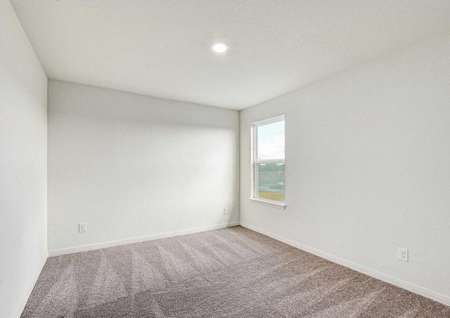 Willow house plan bedroom with brown carpet, white on white wall paint, and recessed light