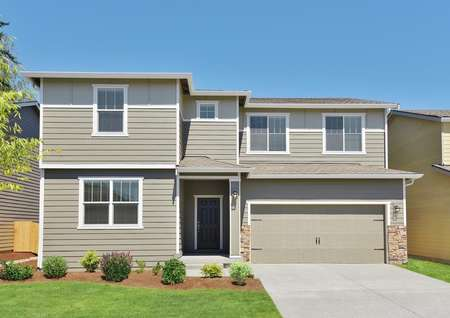 Exterior photo of the Pearl by LGI Homes with tan siding and front yard landscaping.