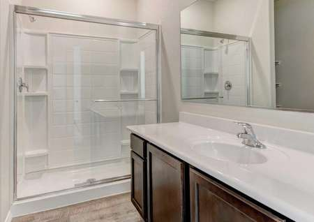 Bisbee bathroom with white countertop and walk-in shower unit