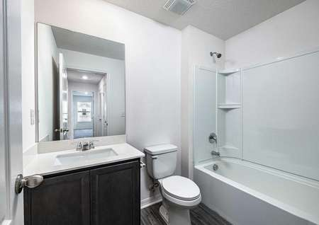 Spare bathroom on the second floor with a sink, toilet and shower/bathtub.