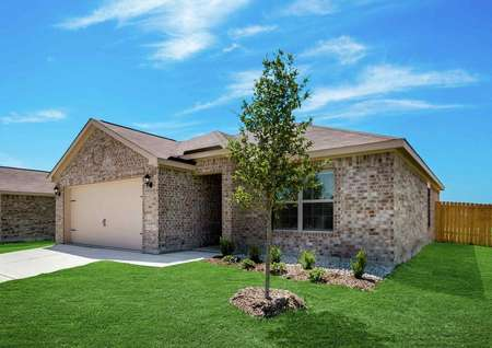 Rio Grande finished house front yard with brick walls, wood fencing, and landscaping