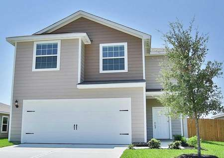 The Mesquite two-story model with a two-car garage, tan and dark brown exterior siding with white trim and a white front door
