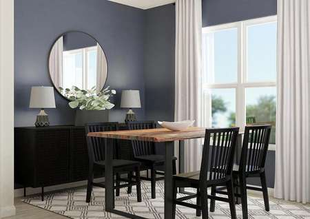 Rendering of the   dining room with wood-look flooring covered by a rug, large window, accent   blue walls, dining table and buffet table.