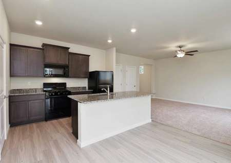Hawthorn kitchen with custom brown cabinets, recessed lights, and hardwood looking floors