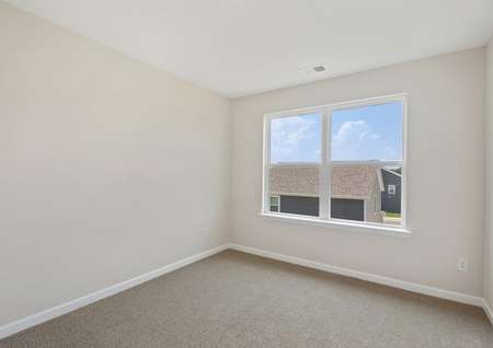The master bedroom has brown carpet and tan walls with white trim.