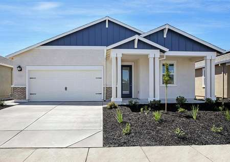 The Cooley plan has a beautiful light stucco exterior with a covered front porch.