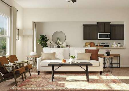 Rendering of living room focused on white   couch, brown coffee table and two armchairs with dining and kitchen areas in   the background