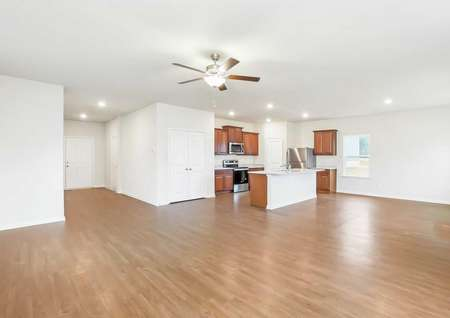 Spacious family room, ceiling fan and kitchen area.