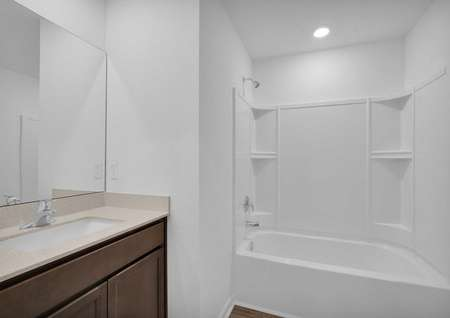 Full bathroom with a bathtub and plenty of countertop space.