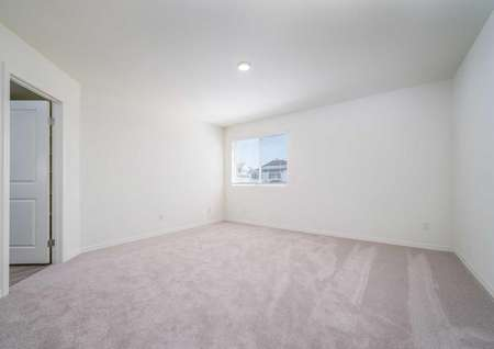 Redondo bedroom with light colored carpet, French doors, and overhead light