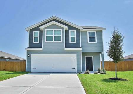 ExteriorOsage floor plan, 2 story home, 2 car garage, siding with shingle roof, wood fence,landscaped front yard