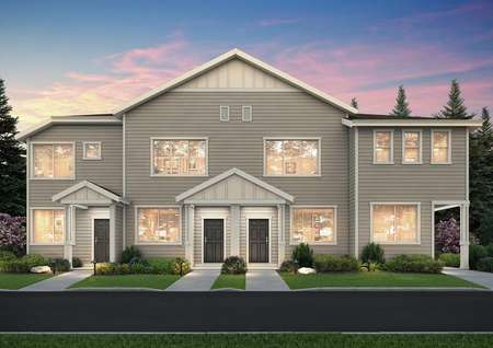 Straight on view of the Harts Crossing townhome plans at night.